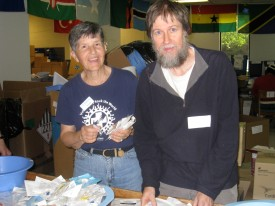 Brian sorting supplies with senior volunteer, Pat Horvath