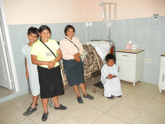 Happy family at Puyo Hospital.  These two boys were being treated for skin abcesses caused by jungle insect bites.