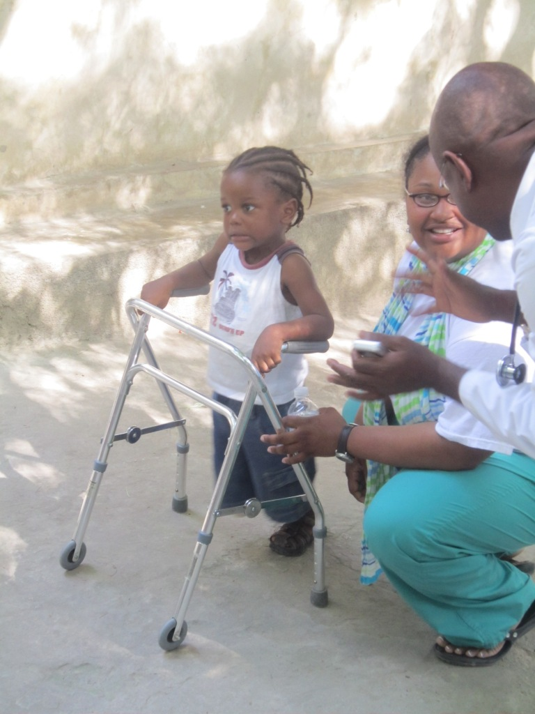A walker donated by MedShare gives a young Haitian amputee the ability to walk again.