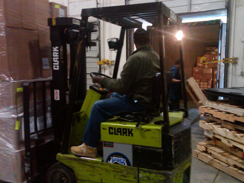 Warehouse staff loading the container