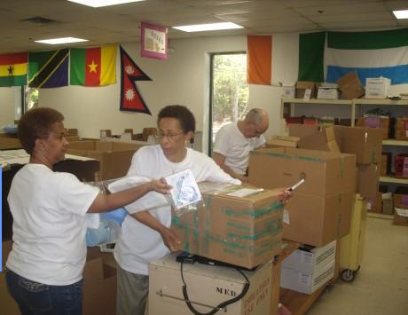 Volunteers sorting medical supplies