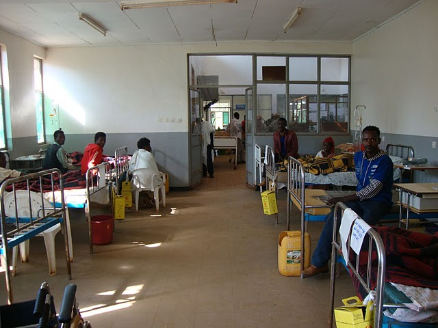 Men's ward, 8+ beds to a room regardless of medical diagnosis