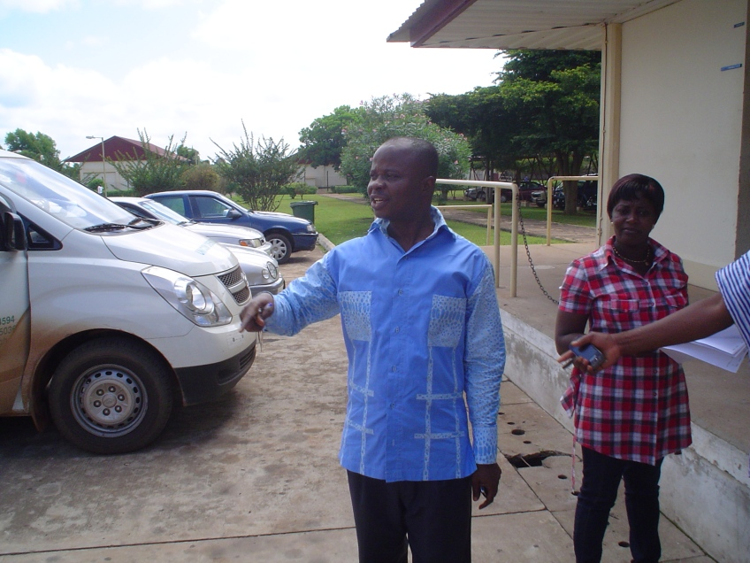 Head of Administration (Mr. Asare-Bediako Abraham) inspecting the off loading process